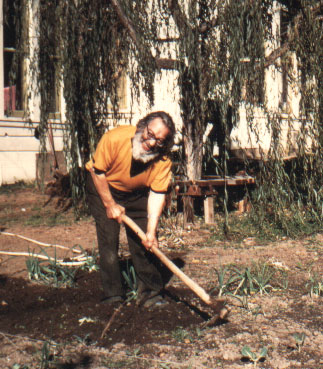 Murshid S.A.M. hoeing in the garden at Garden of Inayat